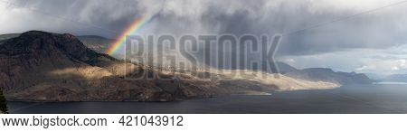 Panoramic View Of Canadian Mountain Landscape In Desert By The Lake. Dramatic Stormy And Rainy Weath