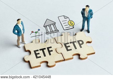 Exchange-traded Product Etp And Exchange-traded Fund Etf On A Connected Puzzle With Businessmen.