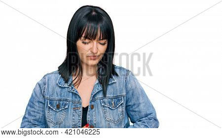 Young hispanic woman wearing casual clothes with hand on stomach because indigestion, painful illness feeling unwell. ache concept.