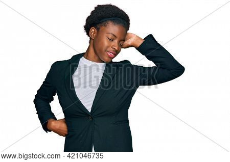 Young african american girl wearing business clothes stretching back, tired and relaxed, sleepy and yawning for early morning