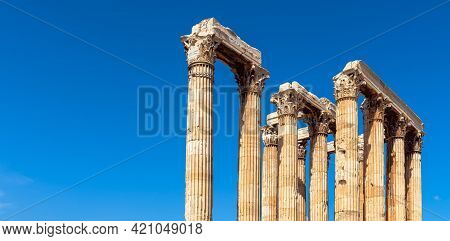 Temple Of Zeus On Blue Sky Background, Athens, Greece. Huge Corinthian Columns Are Remains Of Classi
