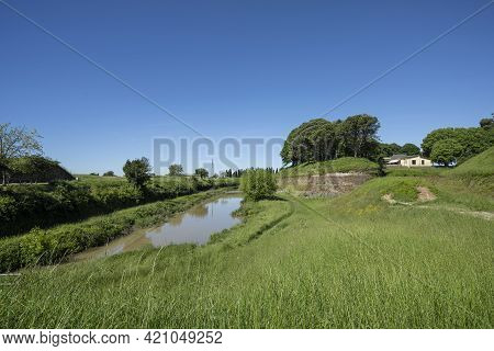 Palmanova, Italy. May 18, 2021.  The Ancient Ramparts Of The Fortifications And The Moat That Surrou