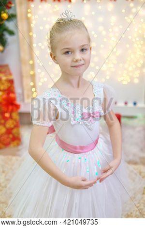 Little ballerina on scene. Children dance сlassical ballet in studio. .