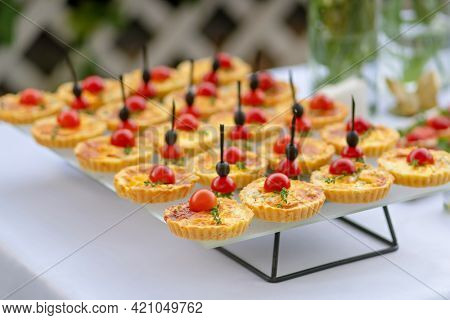 Catering table, set service at restaurant before party. Food design.