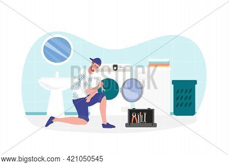 Male Expert Repairman Is Fixing A Washing Machine At Home. Cheerful Man In Casual Clothes Repairing