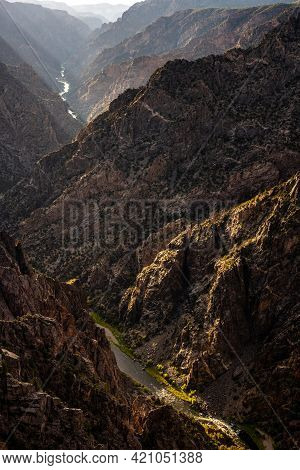 Green Plants Glow Bright In The Dark Canyon Of Black Canyon Of The Gunnison