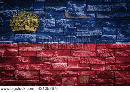 National Flag Of Liechtenstein On Stone  Wall Background.the Concept Of National Pride And Symbol Of