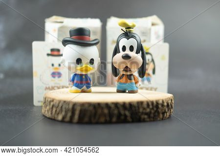 Samut Prakan, Thailand - May 20, 2021 : Cute Figurine Goofy And Scrooge Mcduck (mickey Mouse Family
