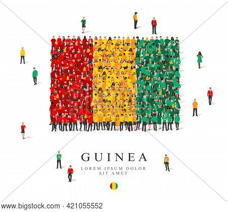 A Large Group Of People Are Standing In Green, Yellow And Red Robes, Symbolizing The Flag Of Guinea.