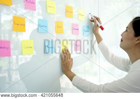 Businesswoman Uses A Pen In Her Hand To Write