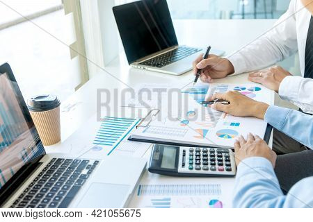 Businessman Pointing At  Graphs Paper