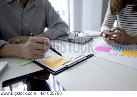 Businessmen Are Showing Business Women Details On Documents In Clipboard