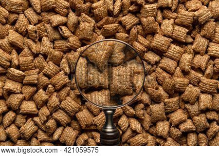 Breakfast Caramel Cereals Square-shaped With Chocolate Filling, View Through A Magnifying Glass. Ful