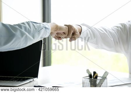 Two Business People Use Hand To Fist Bump For Succes Teamwork Coporate Partner Business Trust Teamwo
