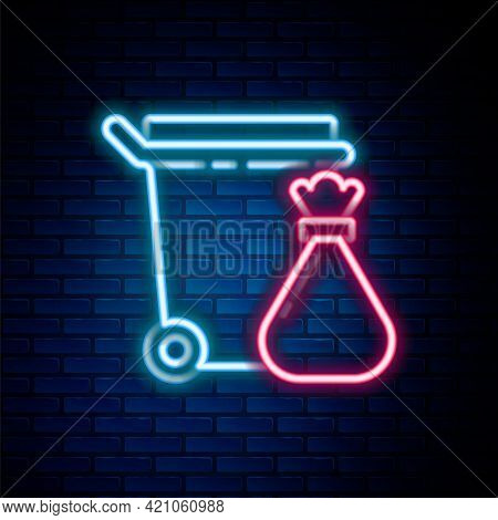 Glowing Neon Line Trash Can And Garbage Bag Icon Isolated On Brick Wall Background. Garbage Bin Sign