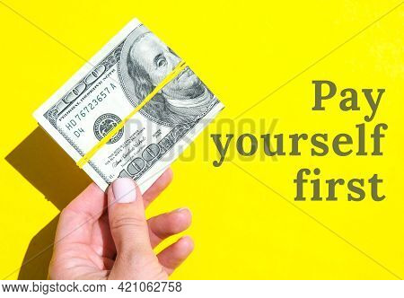 Pay Yourself First Quote Female Hand Holding Dollars Close Up. Money Currency. Online Shopping. Givi