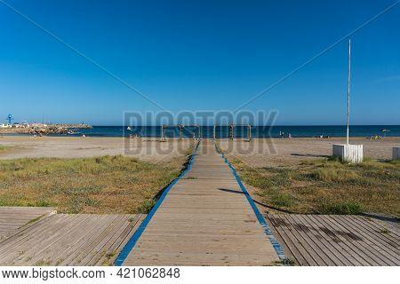 Wooden Walkway To San Jose Beach In The Town Of Nijar, Almería. Andalusian Coast In Cabo De Gata. Sp
