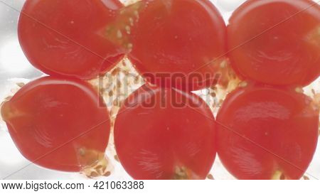 Crushed Tomatoes On Isolated Background. Stock Footage. Bottom View Of Crushed Tomatoes Under Pressu
