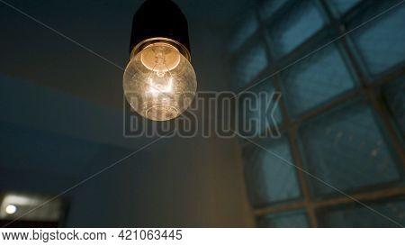 Light Bulb And Light Flash In Dark Room. Stock Footage. Frightening Dark Room With Blinking Bulb. Ne