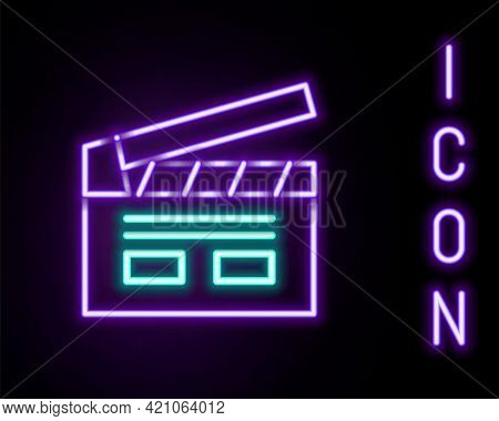 Glowing Neon Line Bollywood Indian Cinema Icon Isolated On Black Background. Movie Clapper. Film Cla