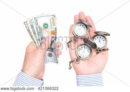 Crop View Of Male Hands Holding Pocket Watches In One Hand And And Dollar Bills In The Other Isolate