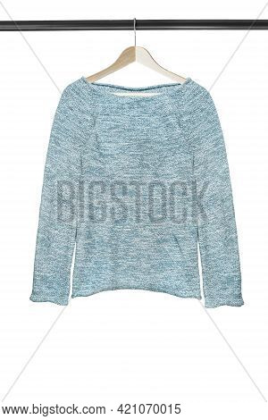 Blue Melange Knit Pullover Hanging On Wooden Clothes Rack Isolated Over White