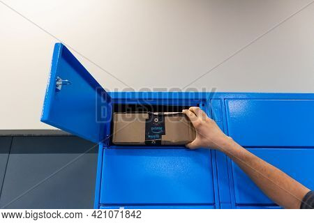 Sabadell, Spain - 30 March 2021 - Young Man's Hand Picking Up A Package From An Amazon Locker In Spa