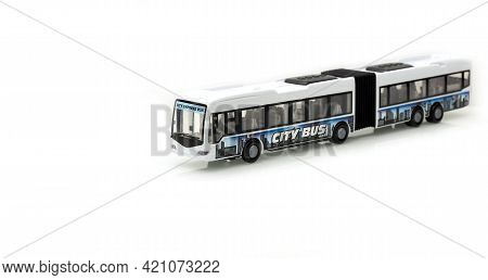 Articulated City Bus. Stretch Bus. Accordion Bus On A White Background. Toy Bus. Isolate.