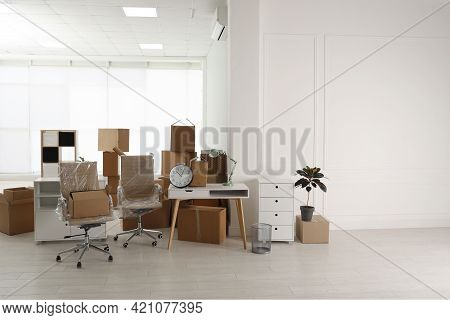 Cardboard Boxes And Packed Stuff In Office. Moving Day