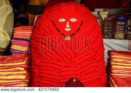 Stock Photo Of Vermillion Or Red Powder Pyramid Kept In Street Shop Outside Hindu Temple For Attract