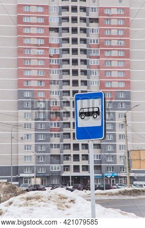 Bus Stop Road Sign On The Background Of A High-rise Building. City Life And Road Traffic Concept. It