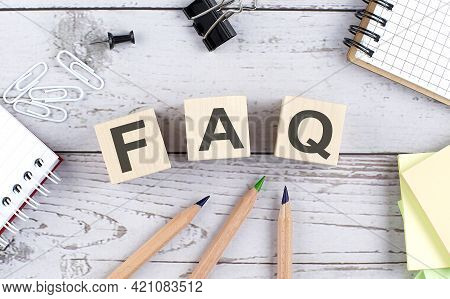 Faq Text On Wooden Block With Office Tools On Wooden Background