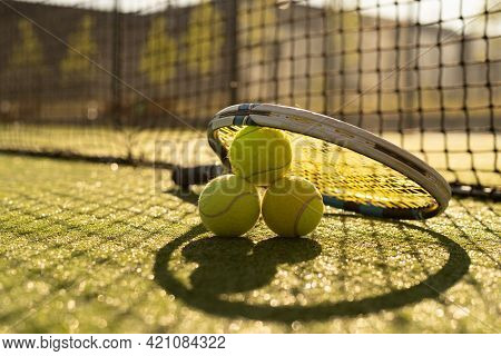Tennis Game. Tennis Ball With Racket On The Tennis Court. Sport, Recreation Concept.