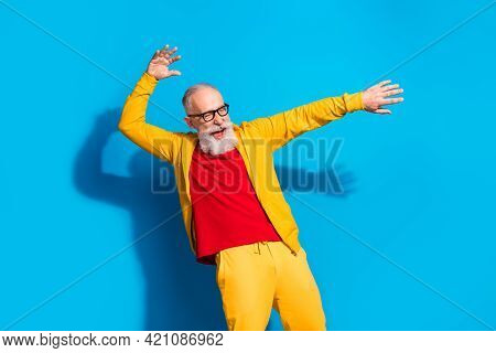 Photo Of Happy Excited Crazy Funky Funny Energetic Mature Man Dancing Having Fun Isolated On Blue Co