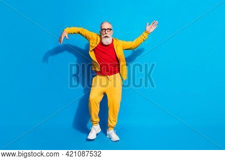 Full Size Photo Of Funky Funny Handsome Mature Man Dancing Make Silly Moves Isolated On Blue Color B