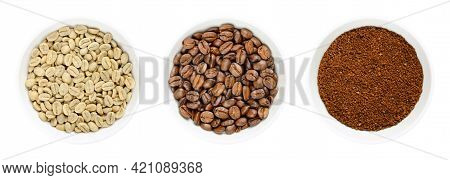 Green, Roasted And Ground Coffee Beans In White Bowls. Seeds Of Berries From Coffea Arabica, Also Ar