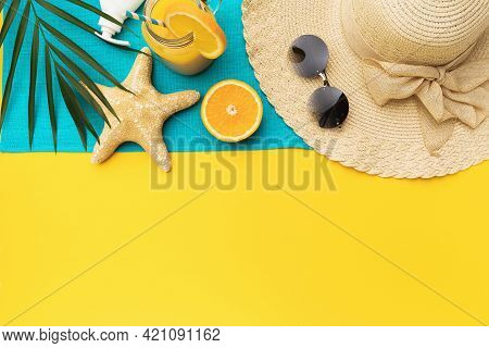 Beach Holiday Accessories, Orange Juice And Palm Leaf On A Yellow Background With A Copy Of Space, S