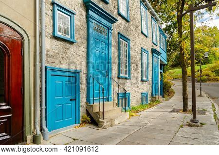 Stone Buildings Of Townhouse With Blue Shutters, Typical Of Old Town Quebec City In Quebec,  Canada