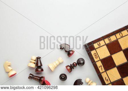 Symbol Of Competition. Chess Board And Chess Figures On Grey Background