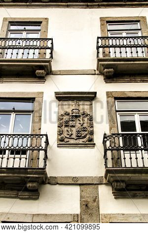 Porto, Portugal- January 5, 2020: Beautiful And Old Colorful Tiled Facades In Porto City In January