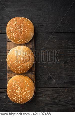 Burger Buns, Homemade Sesame Buns Patty Brioche For Sandwich Set, On Wooden Serving Board, On Black