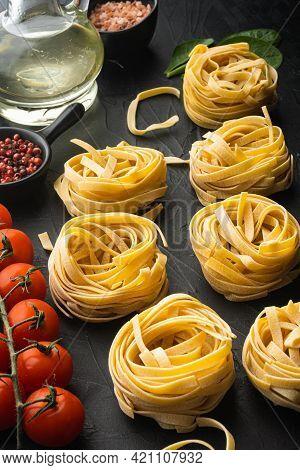 Pasta Ingredients Tagliatelle With Italian Food Ingredients Set, On Black Stone Background