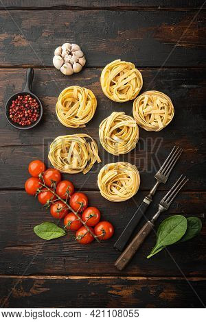 Raw Pasta Tagliatelle With Fresh Tomatoes And Herbs Set, On Old Dark  Wooden Table Background, Top V
