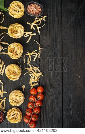Pasta Tagliatelle With Ingredients Set, On Black Wooden Table Background, Top View Flat Lay, With Co