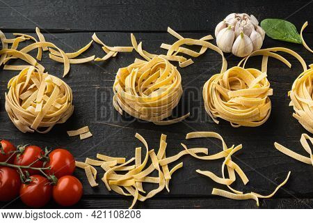 Cooking Tagliatelle Pasta And Ingredients Set, On Black Wooden Table Background