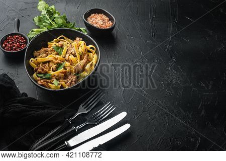Rabbit Stew Tagliatelle Set, In Bowl, On Black Stone Background, With Copy Space For Text