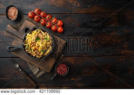 Pasta With Rosemary Rabbit Stew Set, In Frying Cast Iron Pan Or Pot, On Old Dark  Wooden Table, Top