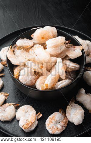 Frozen Peeled Boiled Prawns Set, In Bowl, On Black Stone Background