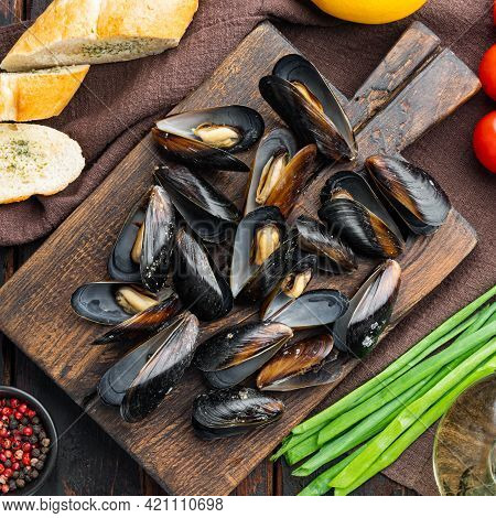 Fresh Mussels With Ingredient, On Wooden Cutting Board, On Old Dark  Wooden Table Background, Top Vi