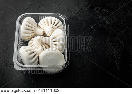 Uzbek Manti. Manti Or Manty Dumplings, Popular Uzbek-asian Dish Set, In Plastic Tray, On Black Stone